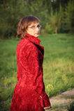 Young woman in red coat Royalty Free Stock Photography
