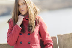 Young woman in red coat Royalty Free Stock Image