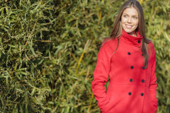 Young woman in red coat Stock Photos