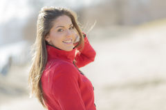 Young woman in red coat Stock Photography
