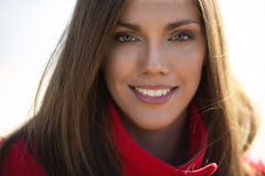 Young woman in red coat Royalty Free Stock Photos