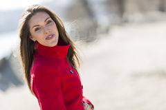 Young woman in red coat Stock Photo