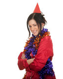 Young woman in red cone hat and Christmas chains Stock Images