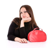 Young woman with red cosmetic bag Stock Photo
