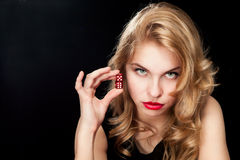 Young woman with red dice Royalty Free Stock Photography