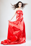 Young woman in red dress Royalty Free Stock Image