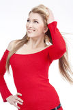 Young woman in red dress Stock Image