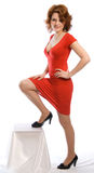 Young woman in red dress. Smiling young woman in red dress. Studio shoot on white background Stock Photos