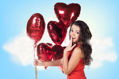 Young woman in red dress with balloons Royalty Free Stock Photography