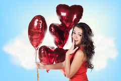 Young woman in red dress with balloons Royalty Free Stock Image