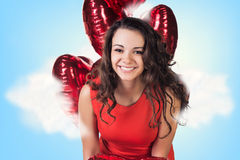 Young woman in red dress with balloons Stock Photos
