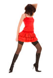 Young woman in red dress and boots Stock Image