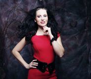 Young woman in red dress Royalty Free Stock Photo