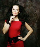 Young woman in red dress. Elegant sensual young woman in red dress Royalty Free Stock Photo