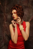 Young woman in red dress. Elegant sensual young woman in red dress Royalty Free Stock Photography