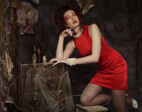 Young woman in red dress. Elegant sensual young woman in red dress Royalty Free Stock Images