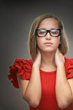 Young woman in red dress and glasses Stock Photos