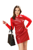 Young woman in a red dress with a handbag Stock Photos