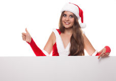 Young woman in red dress and hat with an empty billboard, white backgr Stock Photography