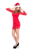 Young woman in red dress and santa hat. christmas Stock Photo