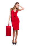 Young woman in red dress with suitcase on Royalty Free Stock Image