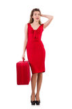 Young woman in red dress with suitcase isolated on Stock Photos