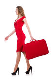 Young woman in red dress with suitcase isolated on Royalty Free Stock Photography