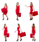 The young woman in red dress with suitcase isolated on white Royalty Free Stock Images
