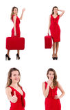 The young woman in red dress with suitcase isolated on white Royalty Free Stock Photo