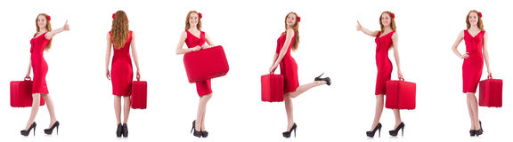 The young woman in red dress with suitcase isolated on white Royalty Free Stock Image