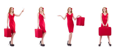 The young woman in red dress with suitcase isolated on white Royalty Free Stock Photography
