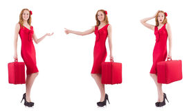 The young woman in red dress with suitcase isolated on white Stock Photo