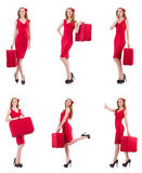 The young woman in red dress with suitcase isolated on white Stock Photography