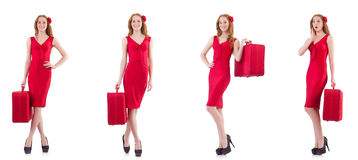 The young woman in red dress with suitcase isolated on white Stock Photos