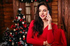 Young woman in red dress  talking on mobile phone Royalty Free Stock Photo