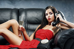A young woman in a red dress  talking on a phone Stock Image