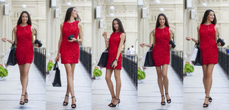 Young woman in red dress walking in the shop Royalty Free Stock Photos