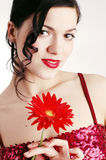Young woman with red flower. Girl with a red herbera Royalty Free Stock Images