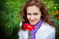 Young woman with red flower gerbera Royalty Free Stock Photography