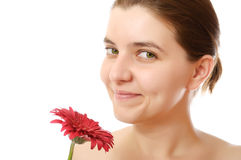 Young woman with red flower Stock Image