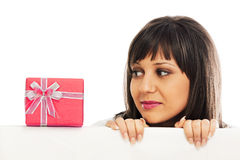 Young woman with red gift Royalty Free Stock Photography