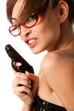 Young  woman in red glasses with handgun Royalty Free Stock Image