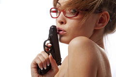 Young  woman in red glasses with handgun Stock Photos