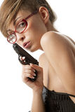 Young  woman in red glasses with handgun Royalty Free Stock Photos