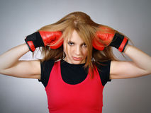 Young woman in red gloves for boxing Stock Photo