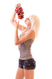 Young woman with red grapes Royalty Free Stock Photos