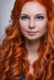Young woman with red hair. Royalty Free Stock Images