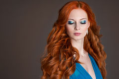 Young woman with red hair. Stock Photo