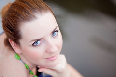 Young woman with red hair and blue eyes Stock Photography