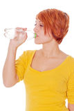 Young woman with red hair drinking Royalty Free Stock Image